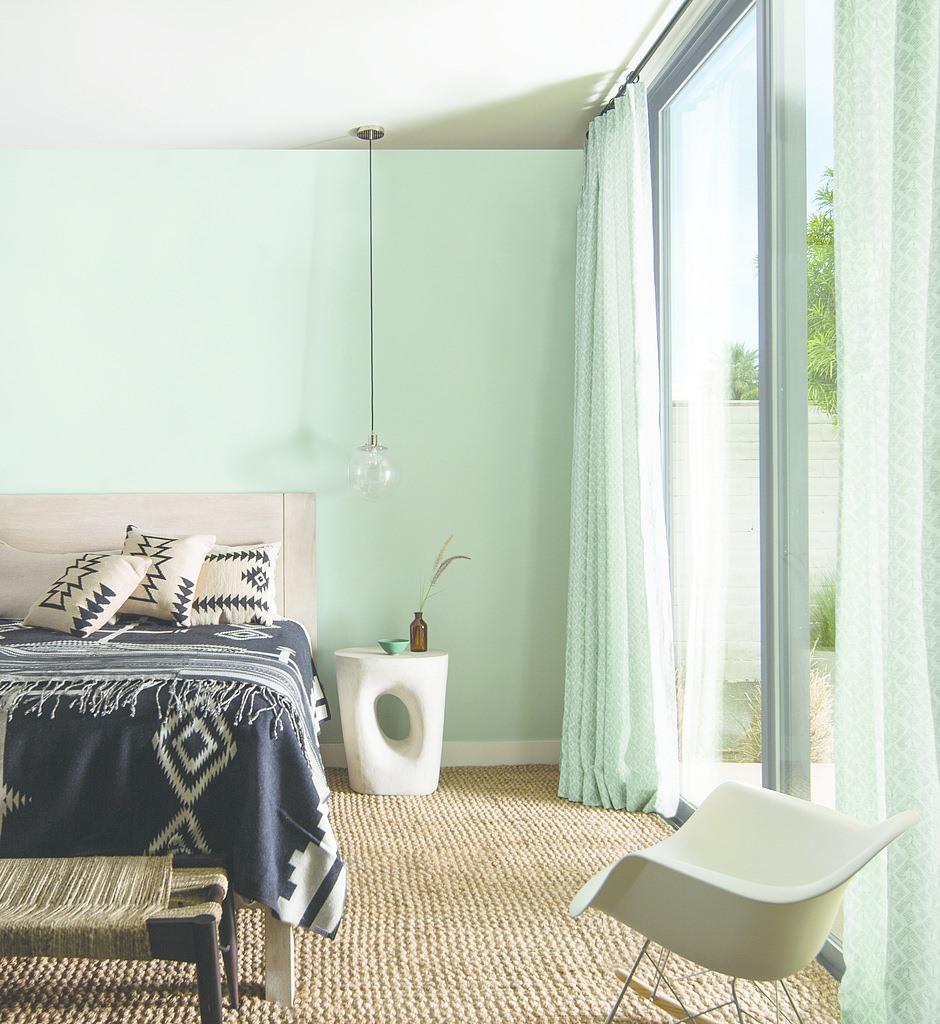 bedroom with seafoam green walls