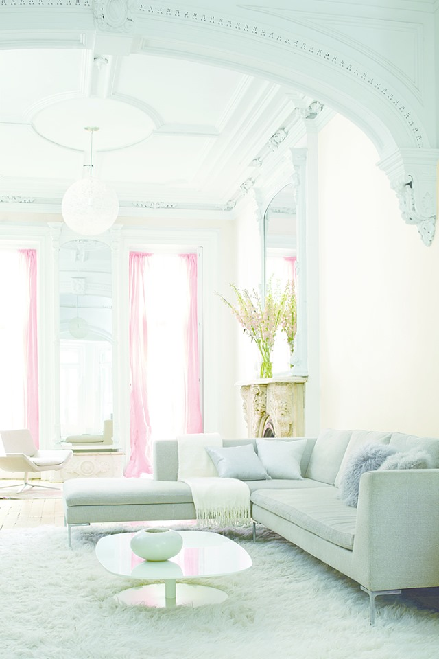 bright room with tall ceilings, couch and light pink curtains