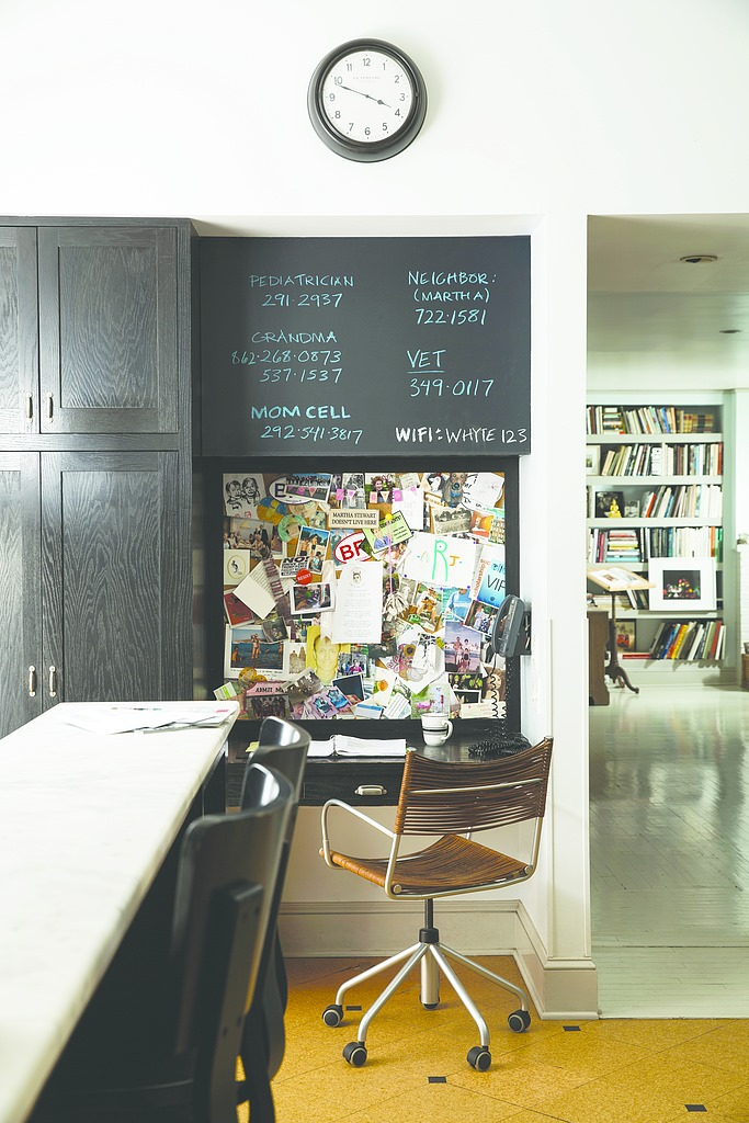 kitchen with chalkboard paint on the wall near a dark cabinet