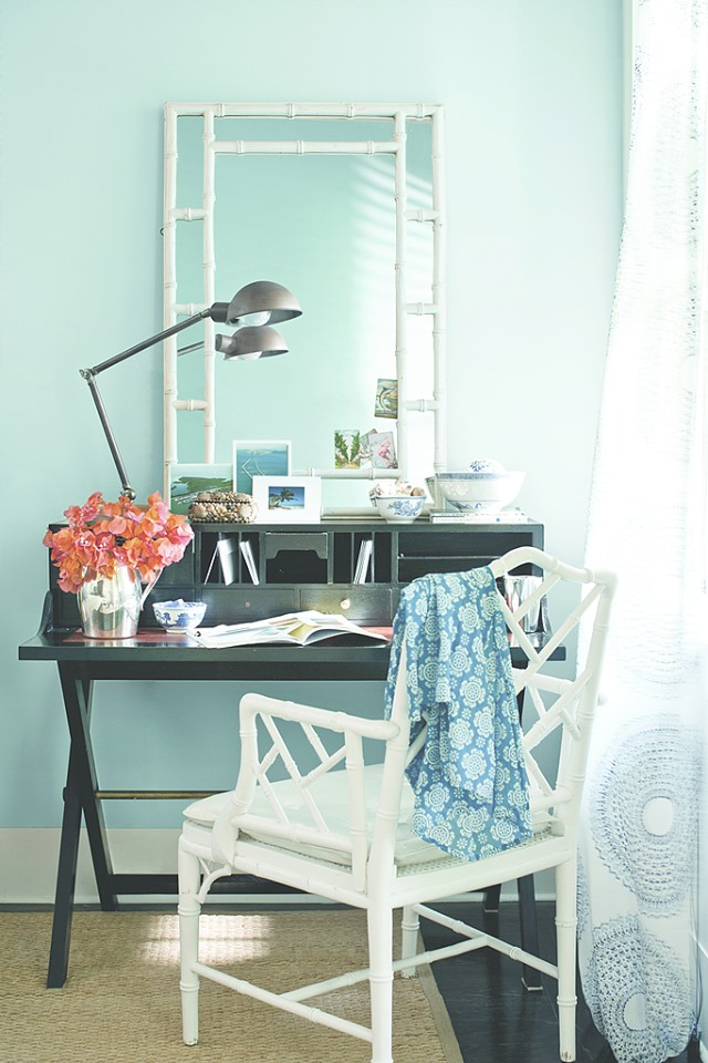 light green office with lamp on desk, mirror and chair in white