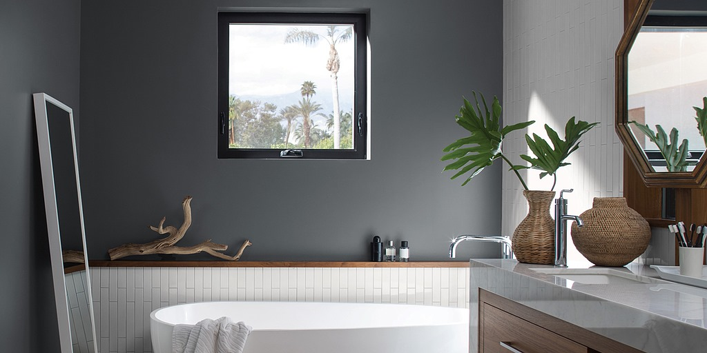 Dark gray walls in a bathroom with white tub