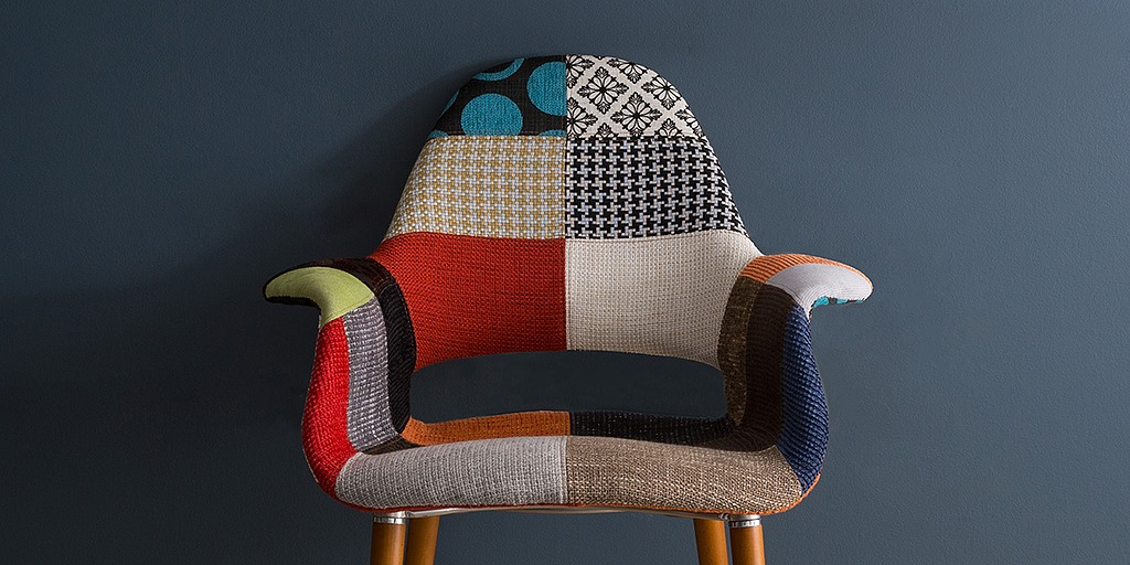 Multi-patterned chair in front of a gray wall