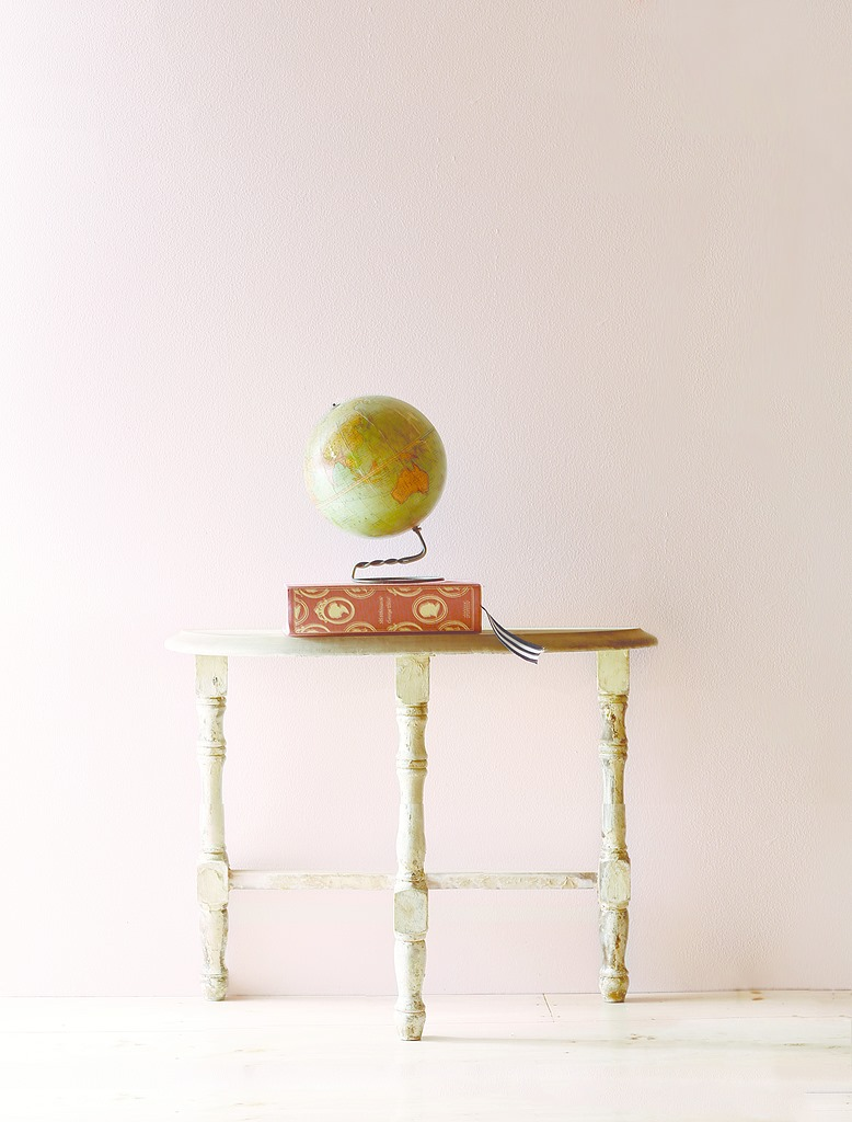 Playful Pink Table with Globe on it