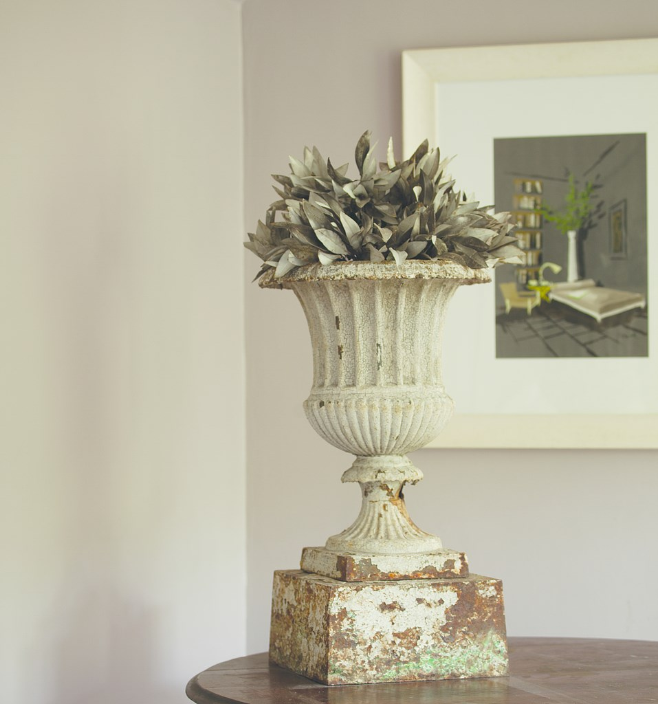 Flower urn against a gray wall