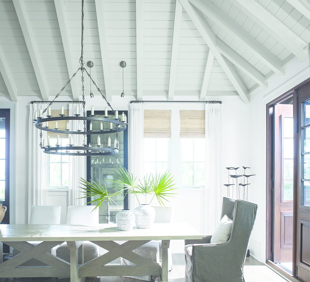 Dining Room table with chairs and white beams and ceiling on top