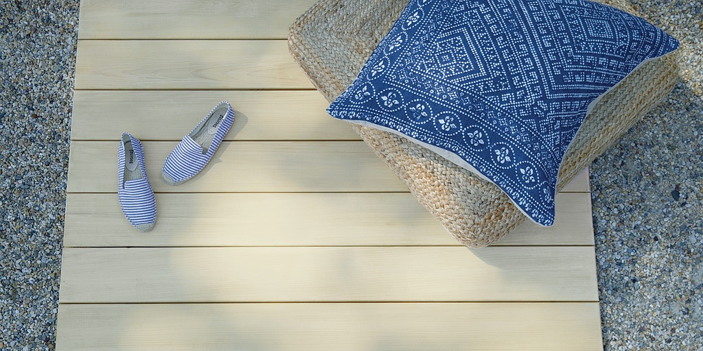 Wood boards with pillows on gravel